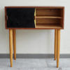 Black and yellow Swedish dresser with right door opened