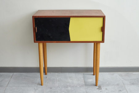 Black and yellow Swedish dresser