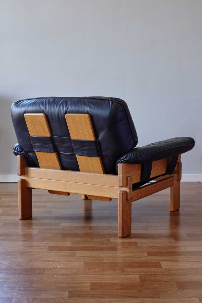 Back of Brazilian armchair in wood and black leather