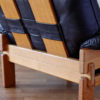 Details of back of Brazilian armchair in wood and black leather