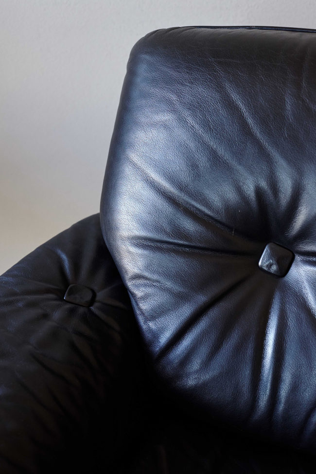 Details of black leather of Brazilian armchair