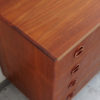 Top view of corner of 4 drawers teak dresser