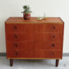 4 drawers teak dresser with objects