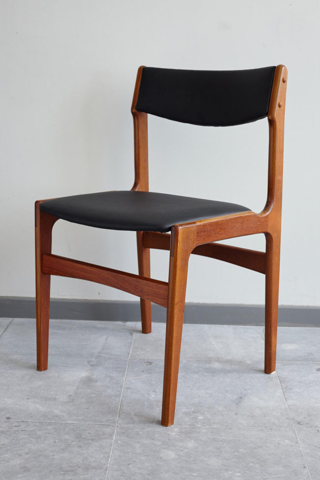 Danish black skai dining chair at an angle