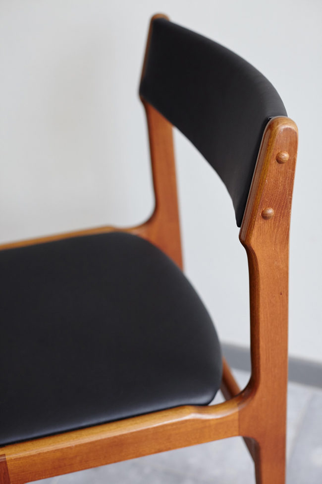 Close up of backrest of Danish black skai dining chair