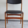 Front of Danish black skai dining chair at an angle