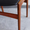 Close up of seat and frame of Danish black skai dining chair at an angle