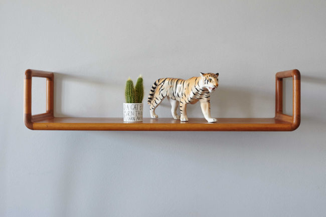 Danish floating shelf with objects