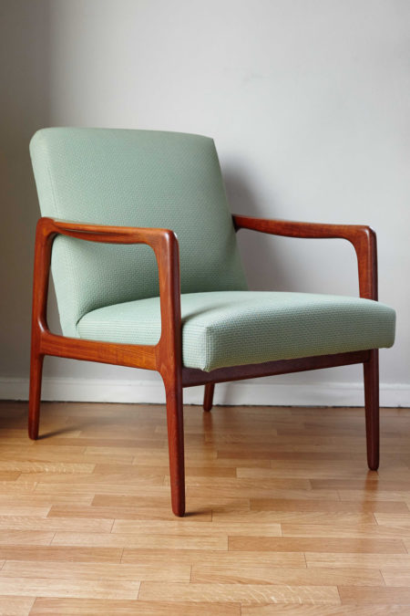 Danish mid-century green armchair at an angle
