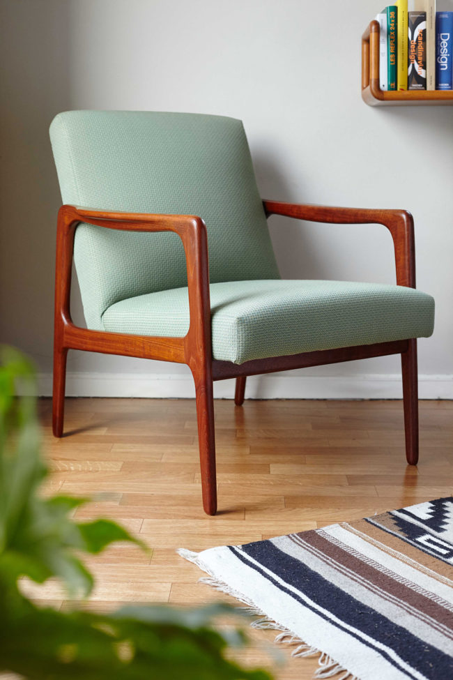 Danish mid-century green armchair in a room