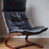 Swedish design black leather lounger by Knudsen at an angle
