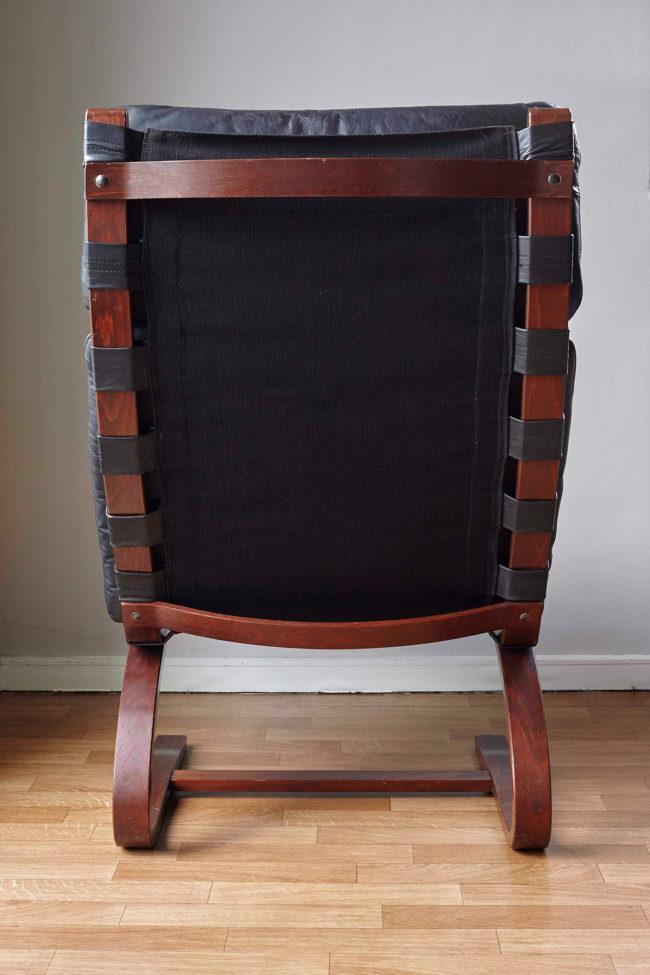 Back of Swedish design black leather lounger by Knudsen