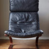 Front of Swedish design black leather lounger by Knudsen