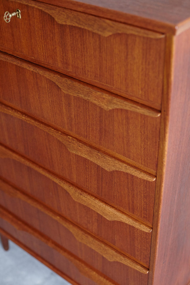 Detail of drawers of Danish teak chest of drawers