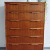 Danish teak chest of drawers with objects