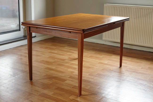 Extendable Danish teak dining table with extensions closed