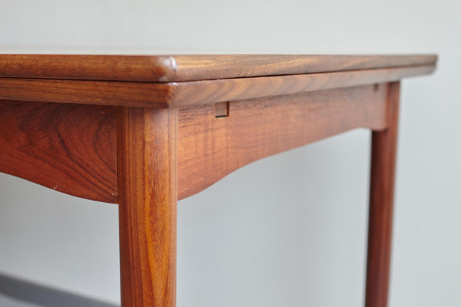 Corner of Danish teak dining table