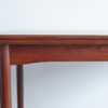 Front view of corner of Danish teak dining table