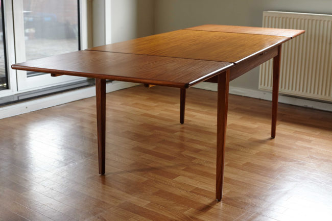Danish teak dining table with extensions open