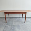 Danish teak dining table with extensions opened