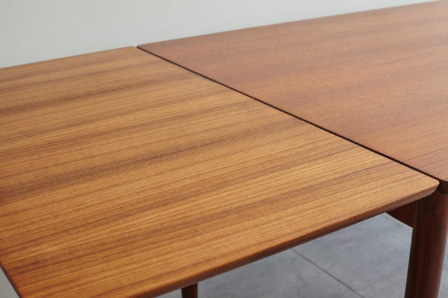 Close up of Danish teak dining table with extension opened