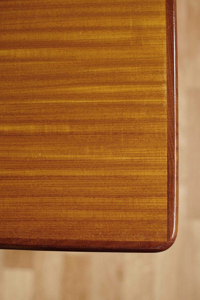 Wood grain close up of extendable Danish teak dining table