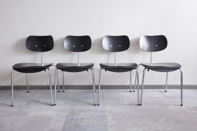 4 Egon Eiermann Wilde Spieth SE68 chairs in a line