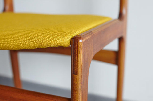 Close up of seat of Danish teak dining chair