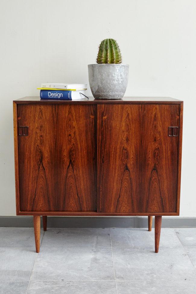 Hjornebo Mobelfabrik rosewood cabinet with objects