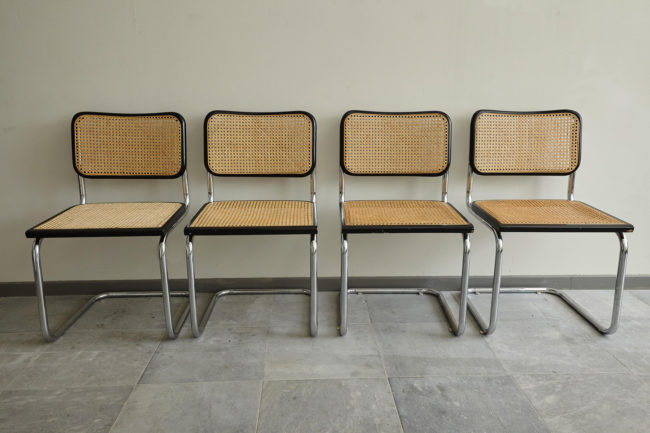 4 Italian wicker chairs in a line
