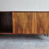 Danish rosewood low sideboard with left door opened