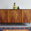 Danish rosewood low sideboard with objects