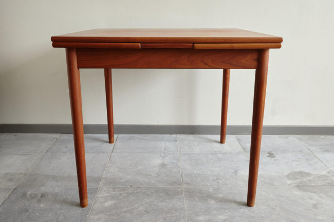 Compact teak dining table