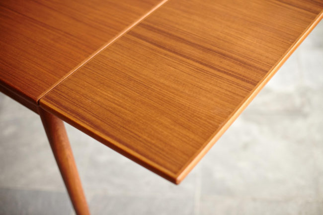 Right extension of Compact teak dining table