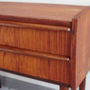 Close up of corner of small Danish teak dresser