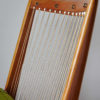 Close up of back frame of Soloform green Boomerang chair
