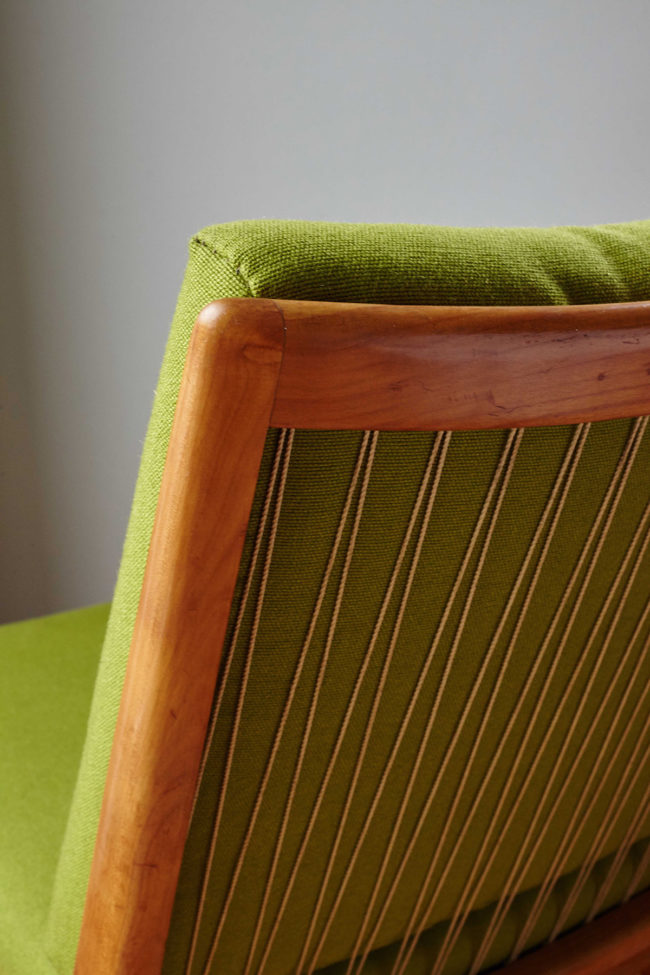 Close up of back of Soloform green Boomerang chair