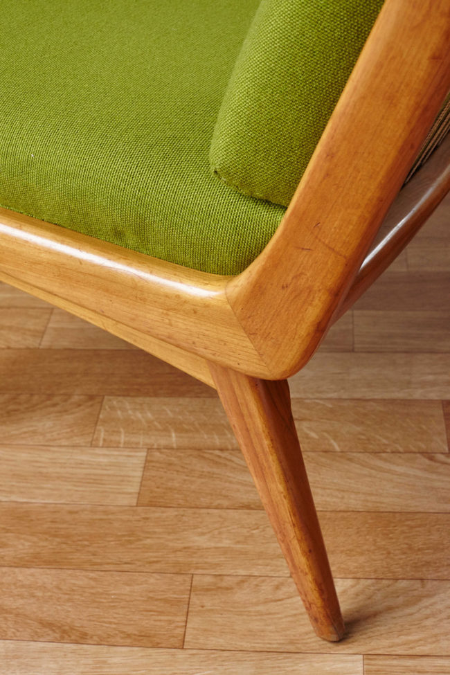 Close up of frame of Soloform green Boomerang chair