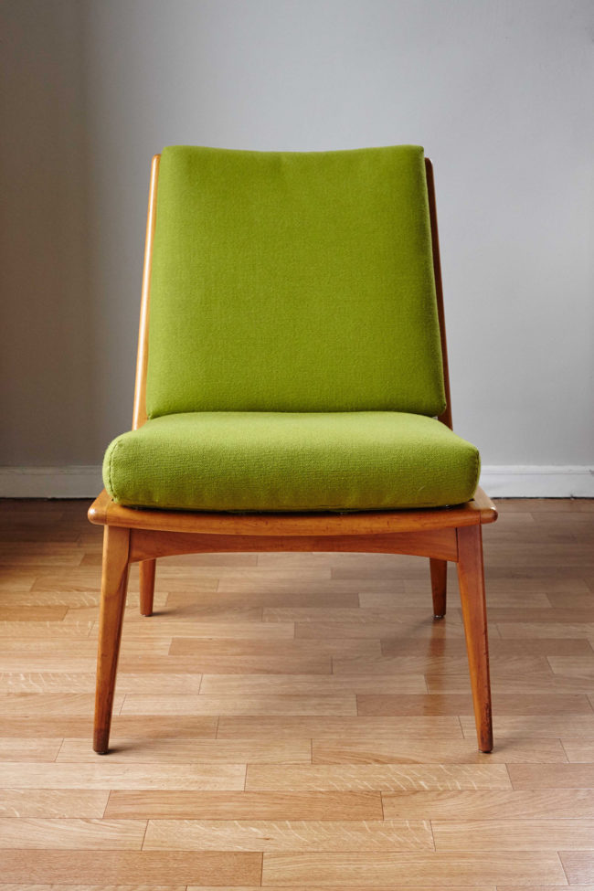 Front of Soloform green Boomerang chair