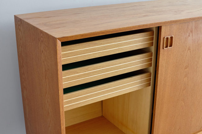 Left-side drawers of Danish oak sideboard
