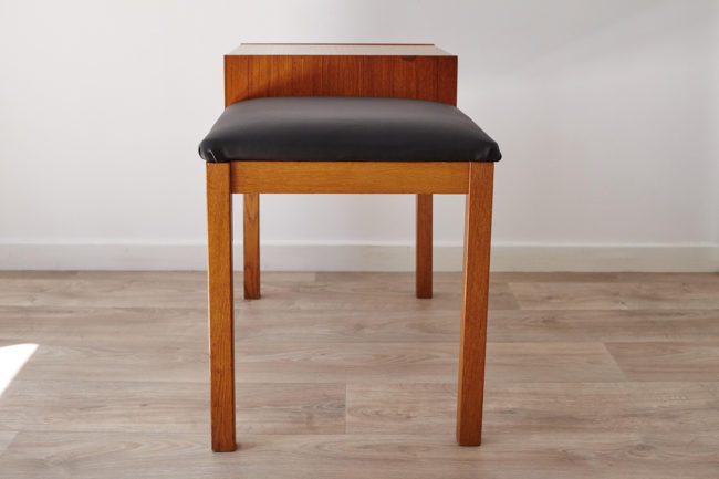 Profile view of Swedish telephone bench with seat