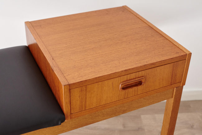 Close up of top of drawer of Swedish telephone bench